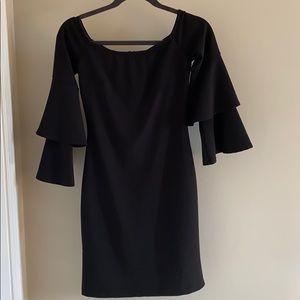 Socialite Dresses - hanging in closet